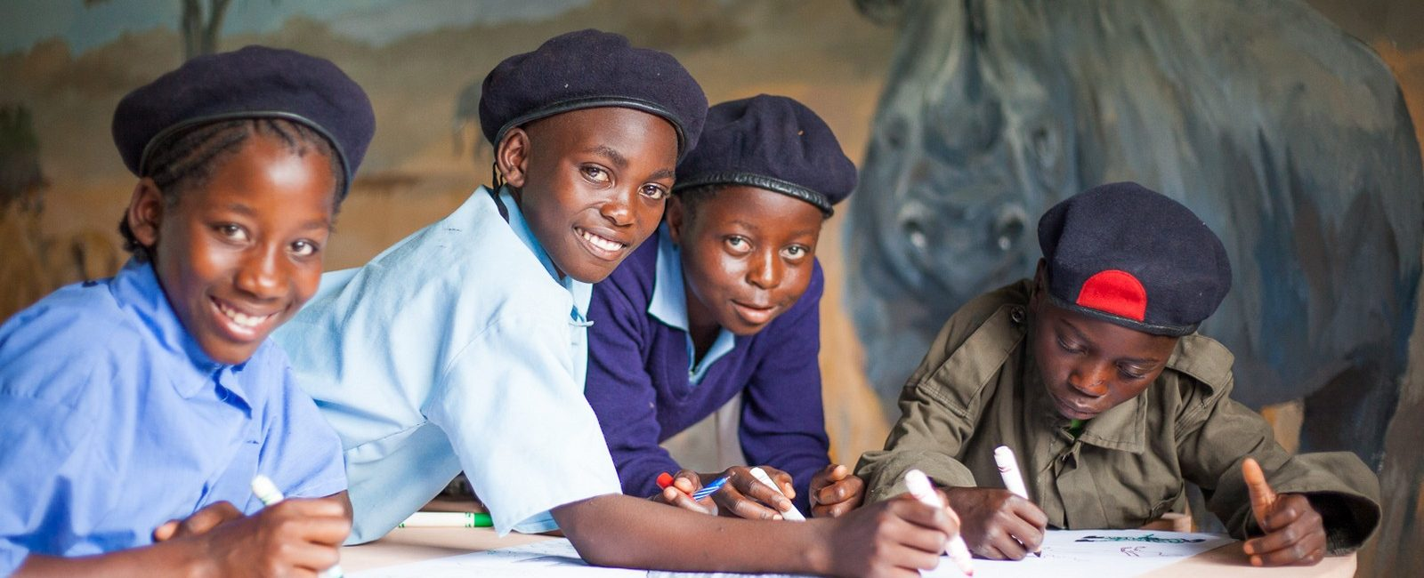 Children in Zambia learn about wildlife and are inspired to love rhino. Credit: Tristan Vince