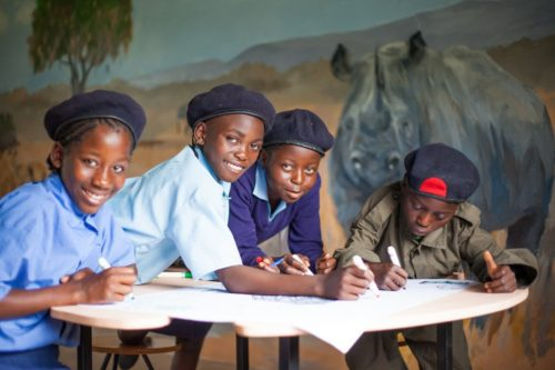 Children in Zambia learn about wildlife and are inspired to love rhino.