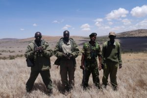 Four rangers on patrol in Kenya.