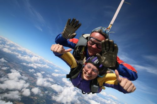 Crystal Mustchin mid-air during a tandem skydive.
