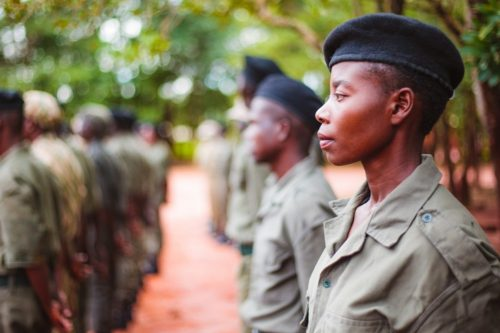 A female ranger stands in North Luangwa.