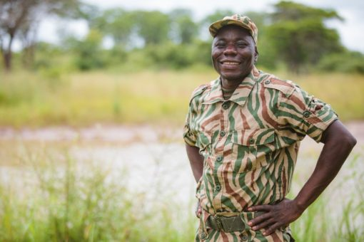 A ranger smiling. Rangers save rhinos each day.