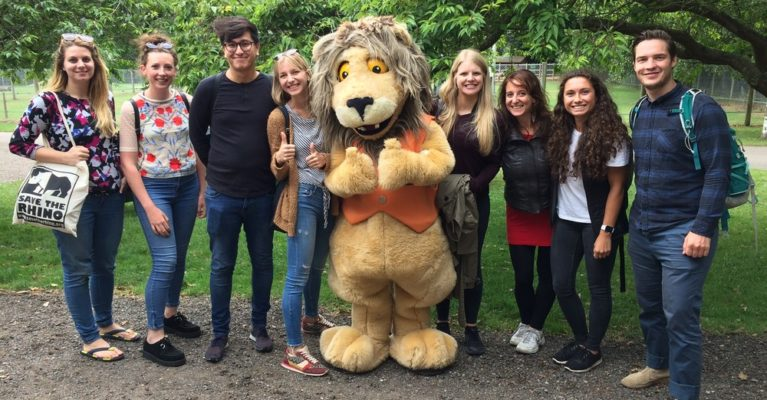 Picture of Save the Rhino team with Reggie the lion at AfricaAlive.