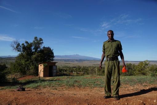 Borana gatehouse with ranger and view of Mt Kenya