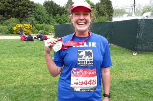 Image of Allie Hunt after the London Marathon with her medal.