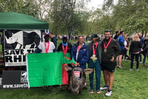 Image of the Zambia team with a Zambia flag after the marathon.