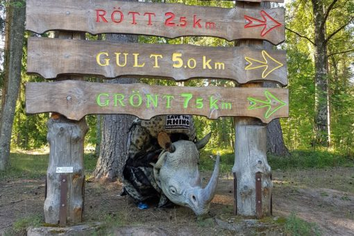 James Last underneath his charity run sign in his rhino costume