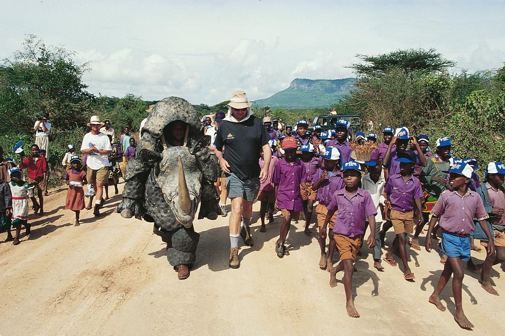 Douglas Adams walking alongside the rhino costume and kids