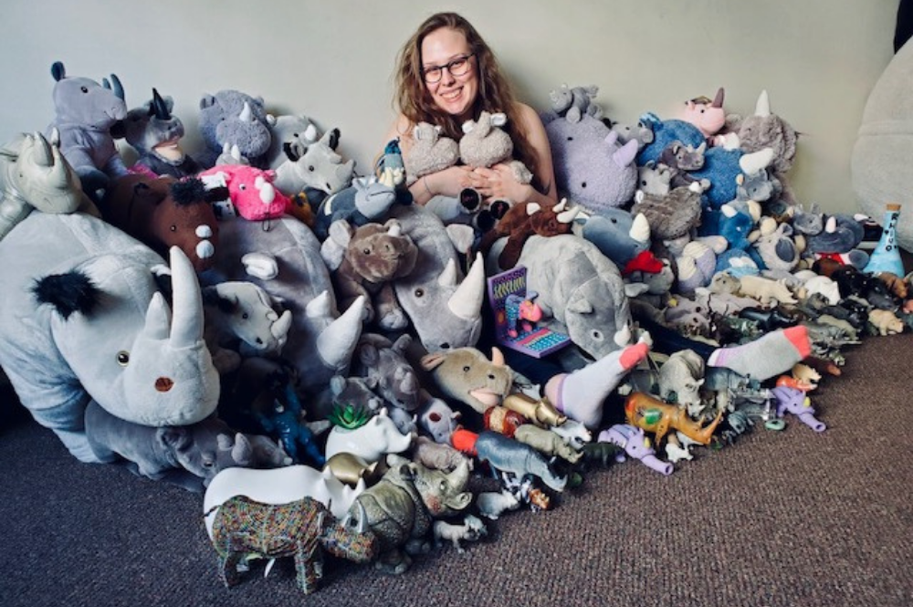 Kylene with her rhino toy collection
