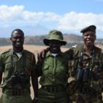 Three rangers smiling
